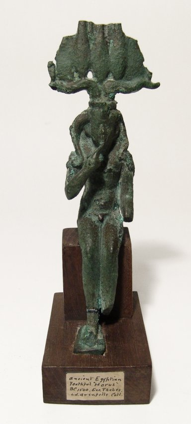 A large Egyptian bronze figure depicted Harpokrates