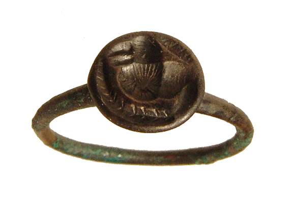 A Roman bronze ring with stylized bird