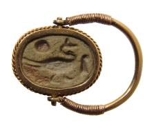 Choice Egyptian scarab in gold swivel ring