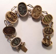 Gorgeous antique gold bracelet with 8 Egyptian scarabs