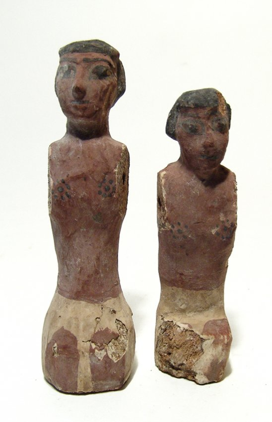 Pair of Egyptian wood figures, Middle Kingdom