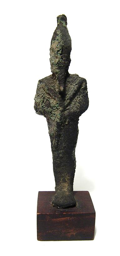 An Egyptian bronze figurine of Osiris