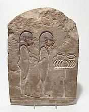 A Ptolemaic Egyptian limestone relief