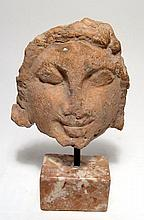 Greek terracotta female face, c. 4th Century BC
