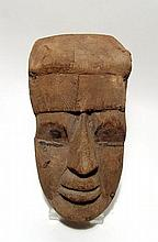An Egyptian wood funerary mask