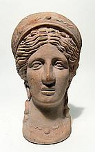 Molded ceramic head of a goddess
