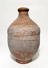 A Coptic red-ware ceramic bottle, Roman Egypt