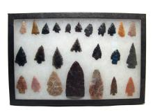 A framed set of 25 Native American arrowheads