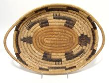 An oval Navajo basket with two handles