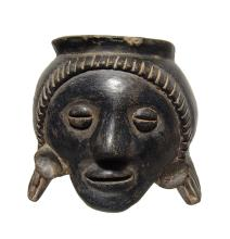 A very nice Colima black-ware face effigy jar