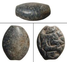 An Ubaid black chlorite stamp seal, Mesopotamia