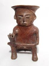 A large and attractive Colima seated figure with peyote