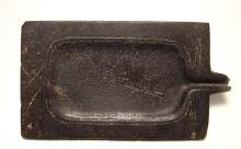 An Egyptian diorite grinding palette, Middle Kingdom