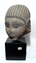 A wonderful Eastern Mediterranean stone head of a youth