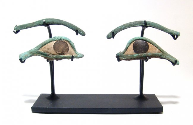 A pair of Egyptian bronze eye and brow inlays