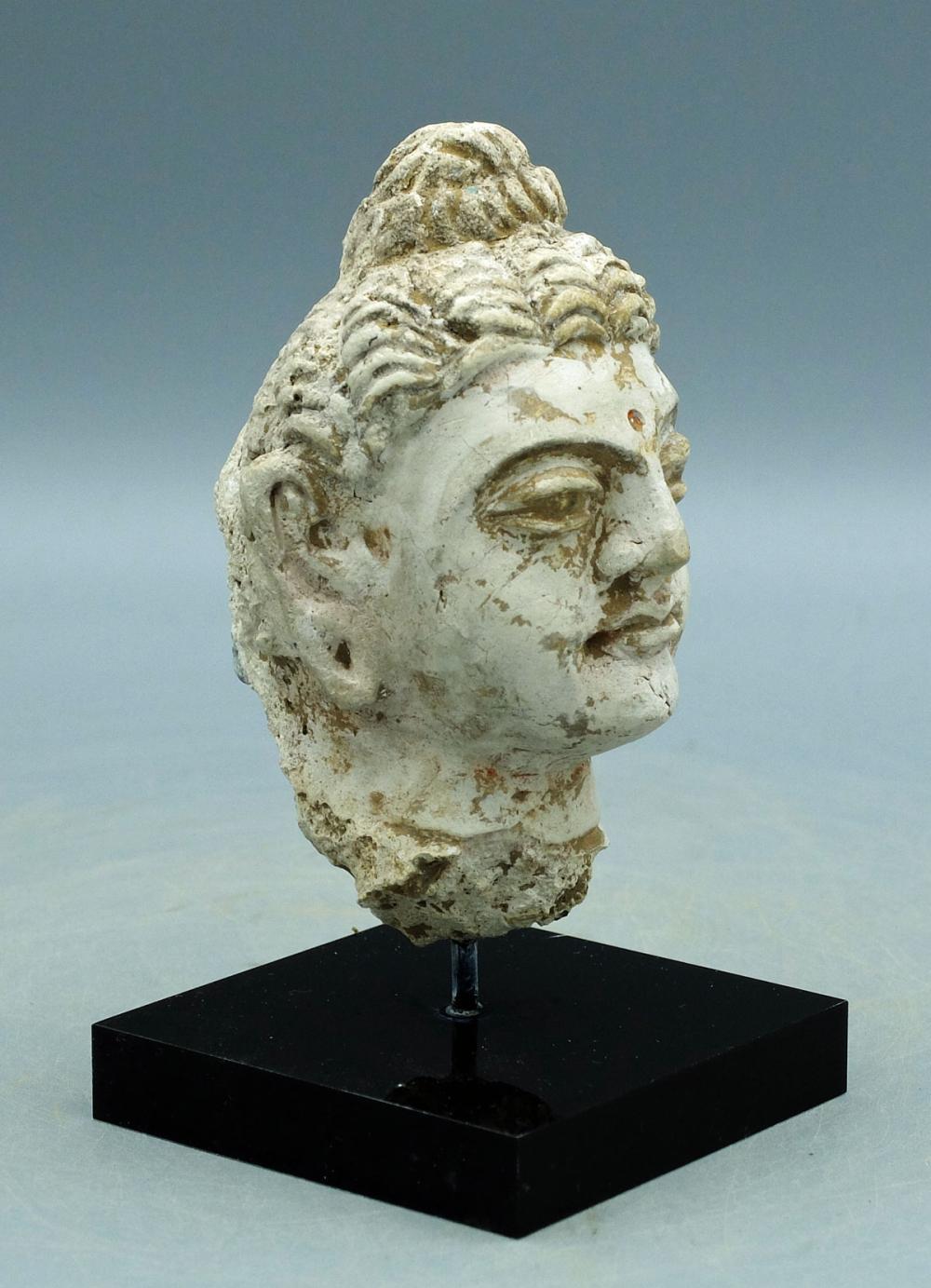 A beautiful Gandharan stucco head of the Buddha