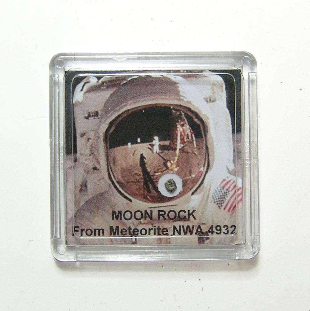 A fragment of moon rock in a display case