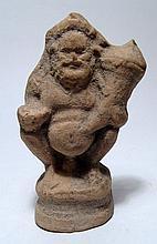 A terracotta figure of squatting Selinus