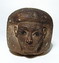 Egyptian limestone canopic jar head of Imsety, New Kingdom