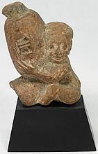 An Egyptian terracotta ithyphallic figure
