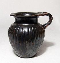 A Greek black glazed olpe, Apulia