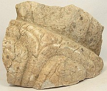 A Near Eastern limestone wall relief fragment