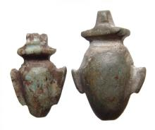 A pair of Egyptian stone 'ib' or heart amulets