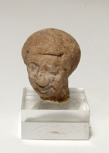 Egyptian head of a man wearing a wig