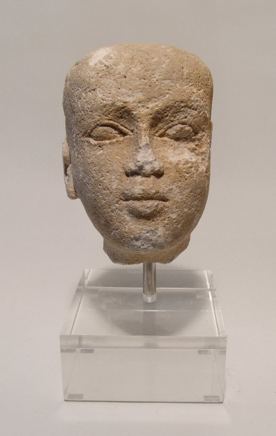 Egyptian limestone head of a male youth, Late Period