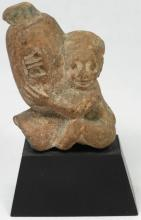 An Egyptian terracotta ithyphallic figure