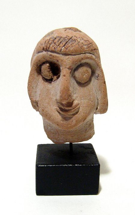An Egyptian Coptic terracotta head of a youth