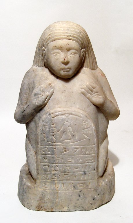 A Sabaean marble sculpture of a kneeling male