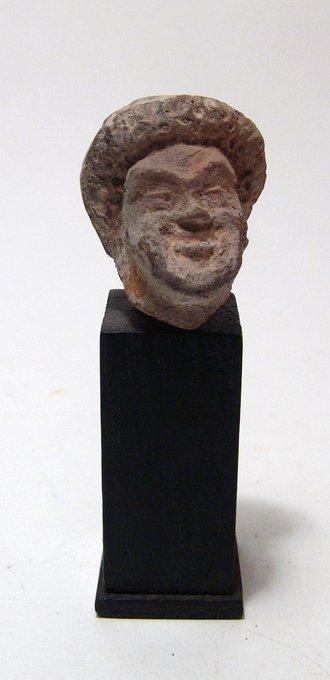 A Greek terracotta head of an actor