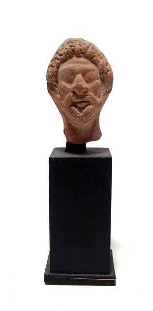 Egyptian terracotta head of a priest, Roman Period