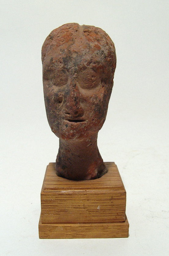 A Near Eastern terracotta head of a woman