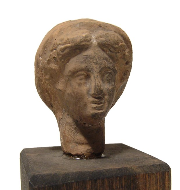 A Greek terracotta head of a woman