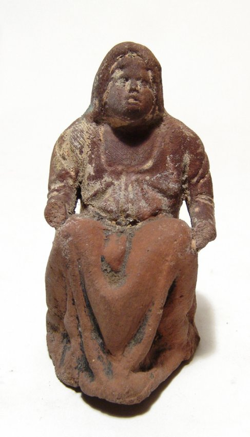 A Greek terracotta figure of a seated woman