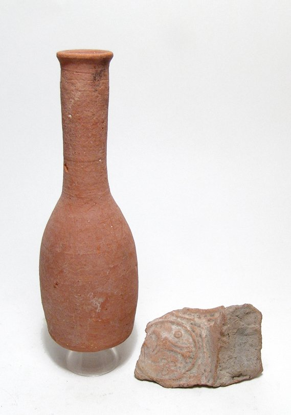 Roman unguentarium and stamped amphora handle