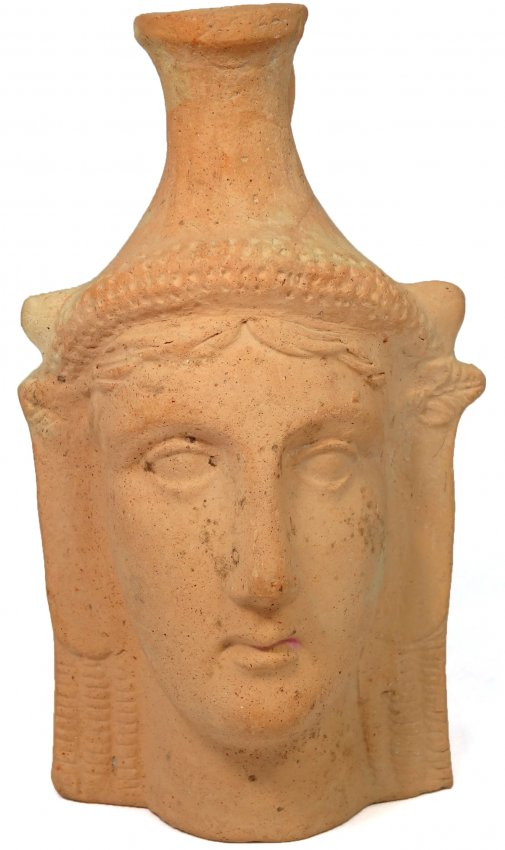 Greek pottery plastic vase depicting a female head