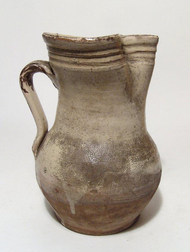 A large Medieval glazed pitcher