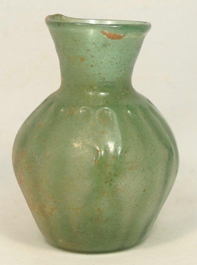 A Roman pale green glass vessel