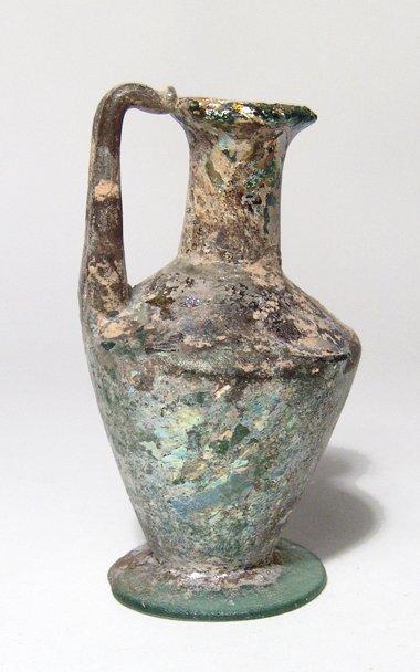 Roman blue-green glass single-handled bottle