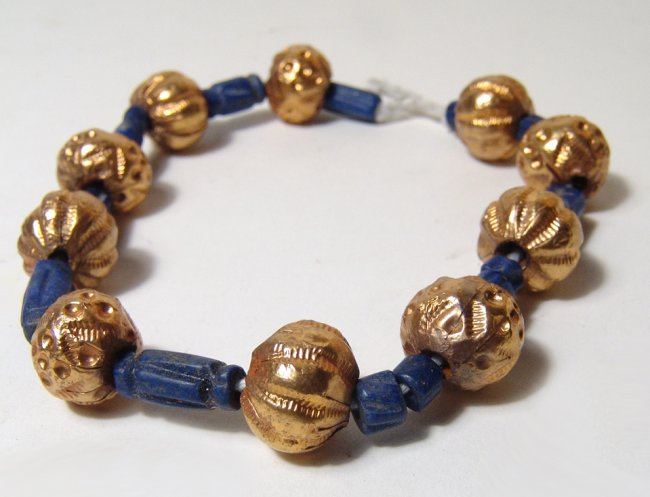 A lapis and gold beaded bracelet