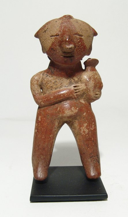 Chinesco standing figure of a mother holding a child