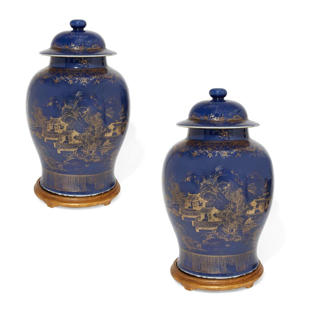 A pair of Chinese gilt decorated blue ground covered jars
