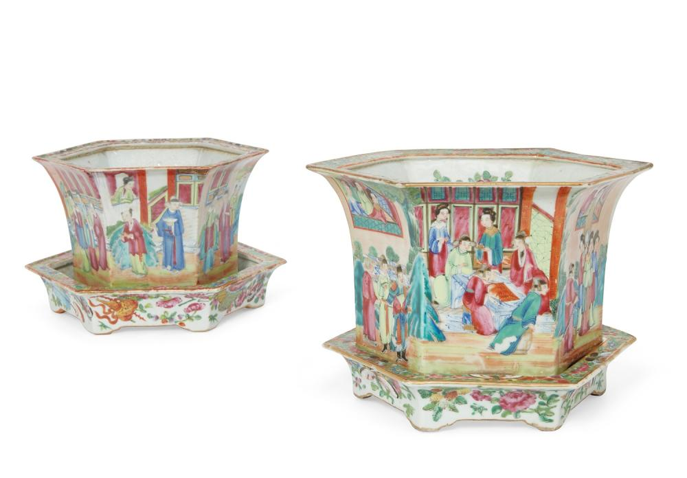 Two graduated Chinese Export Famille Rose porcelain hexagonal jardinières and undertrays