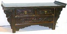 Chinese low stained pine side table, two carved