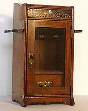 Oak smoker's cabinet with glazed door and integral