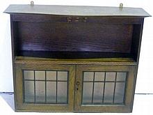 Oak wall cabinet with open section above double