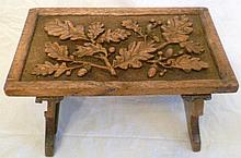 Small Victorian oak footstool, the top carved with